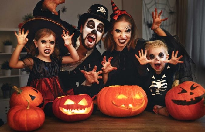 Kid in Halloween costumes.
