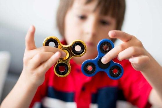 Child with Fidget Spinner.