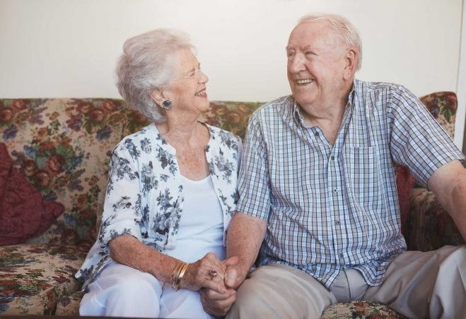 Older couple on couch.