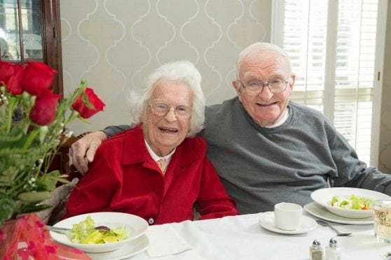 "Marjorie and Wendell ""Buzz"" McKennerney, from left, laugh while reminiscing during the Valentine's Day luncheon held at Mulberry Gardens of Southington."