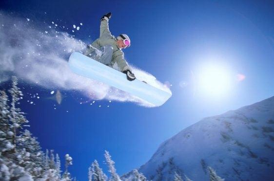Snowboarder, midair.
