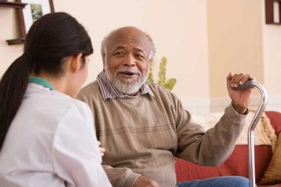 Older man with caregiver.