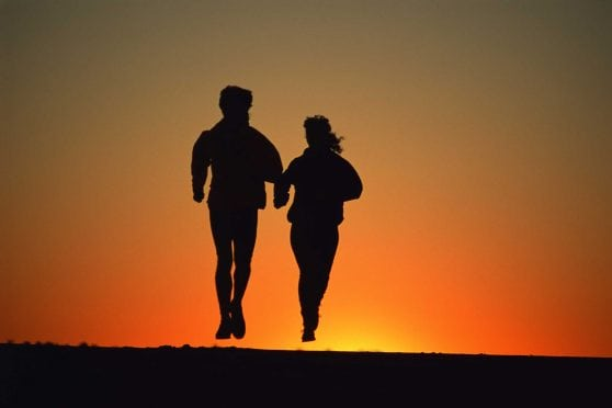 Couple jogging at sunset.