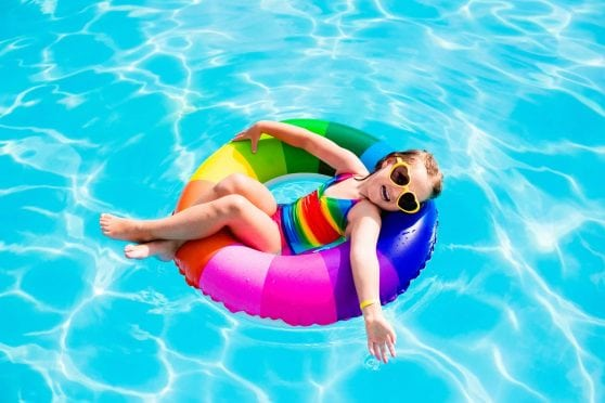 Girl in innertube, with sunglasses.
