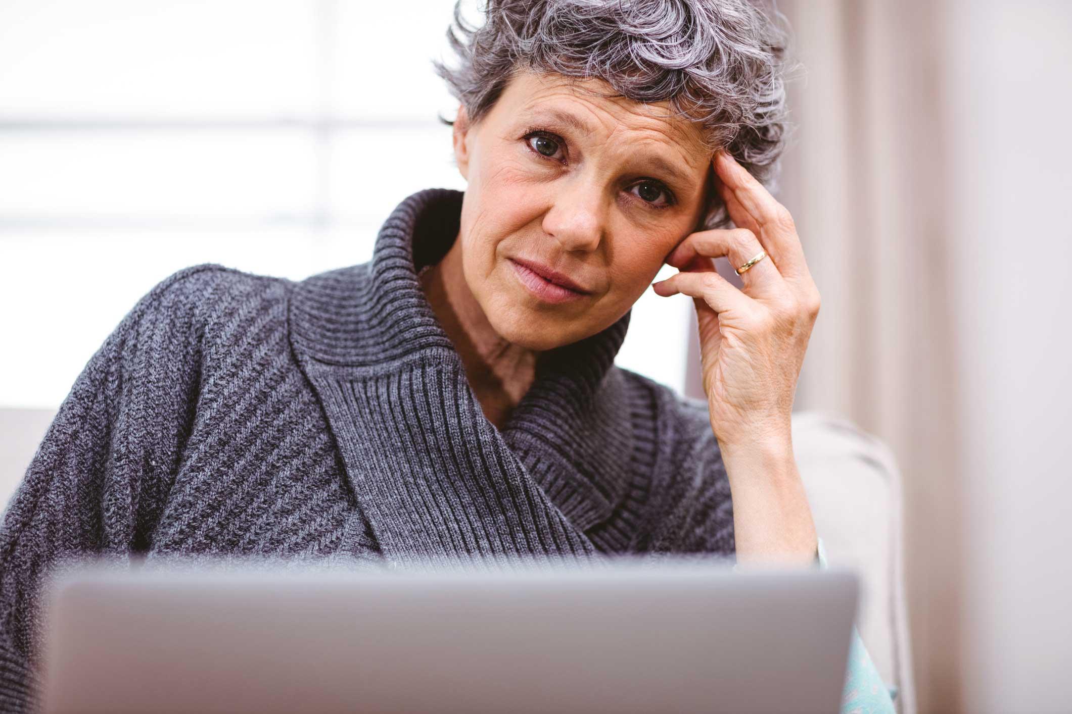 Woman sitting at laptop.