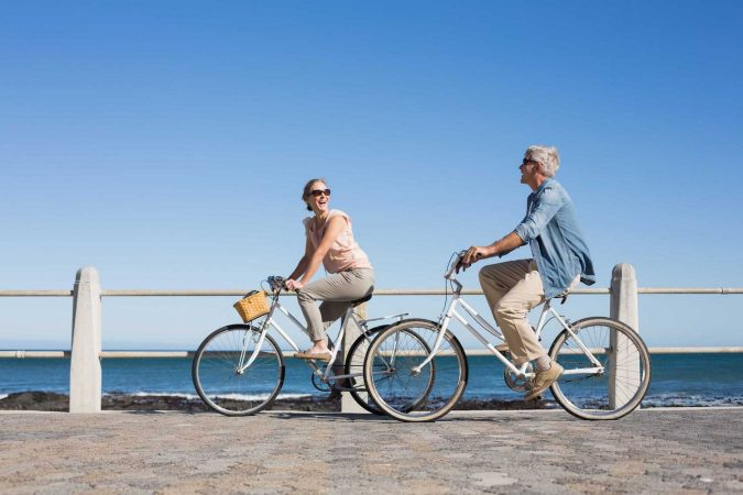 Middle-aged couple on bikes.