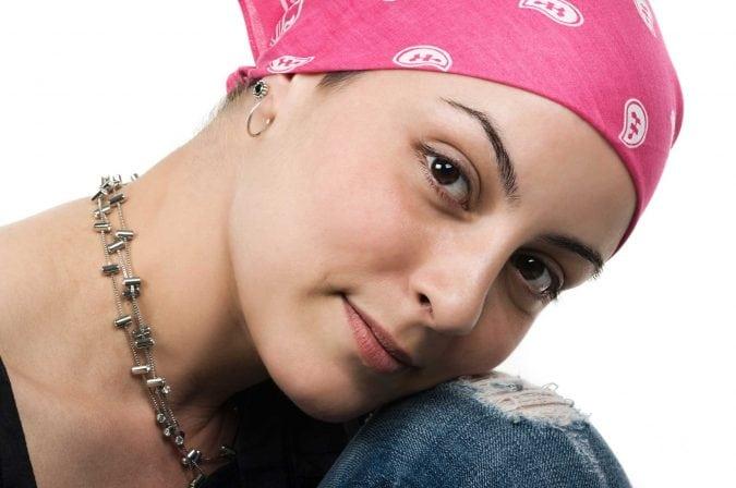 Woman wearing bandana.
