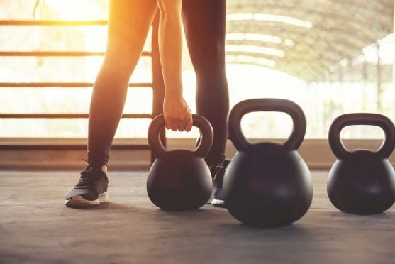 Woman with kettlebell.