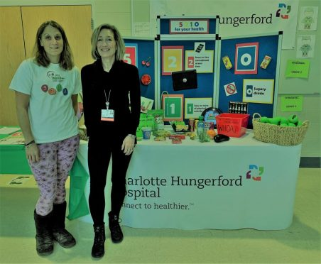 Fit Together Program Coordinator Jessica Stewart (L) and CHH Coordinator of Community Development Joyce Germano (R) promote healthy living at a kindergarten fair in Torrington.